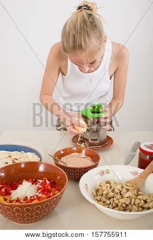 woman preparing ingredients for fajita or doner kebab