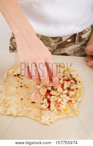 woman preparing of homemade shwarma or doner kebab