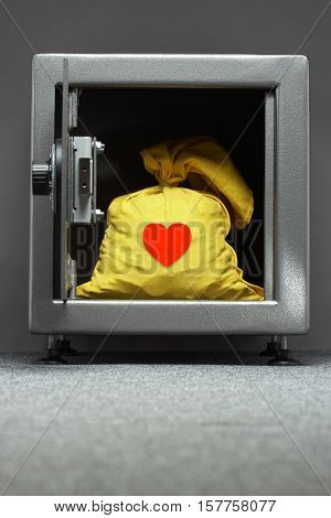 RED Heart on Yellow sack in safe