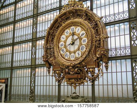 PARIS FRANCE - NOVEMBER 29 2006: The Giant Golden Clock at the Wall of Musee d'Orsay