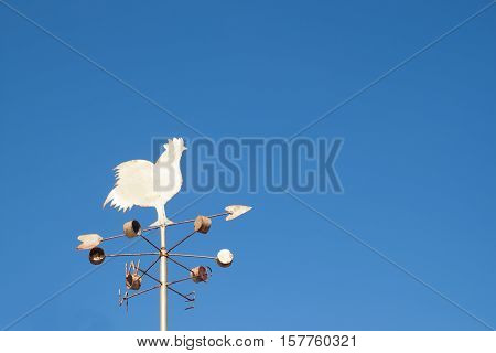 Chicken windmill with blue sky, vintage filter effect
