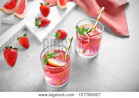 Glasses of refreshing drink on table