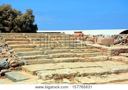 Wide steps to one of the buildings within the Minoan Malia ruins archaeological site Malia Crete Greece Europe.
