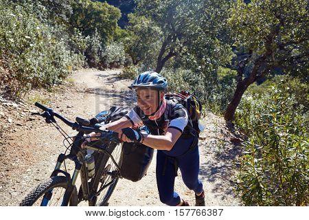 Biker tired at Via de la Plata way in Andalusia Spain to Santiago compostela