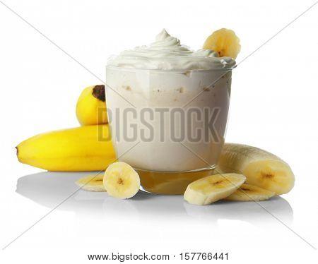 Milk shake with banana slices on white background
