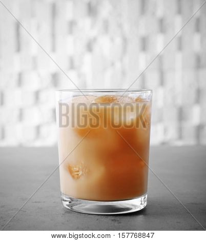 Iced coffee with milk on color background