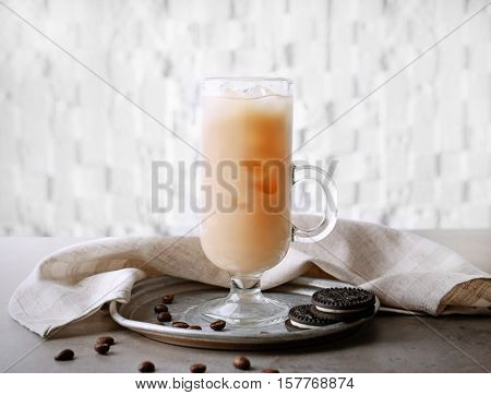 Iced coffee with milk on silver plate