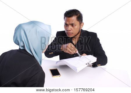 Young Businessmen Pointing To Her Paperwork