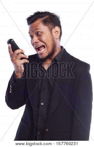 Men Showing His Expression Angry Face While He Pointing His Finger At The Phone