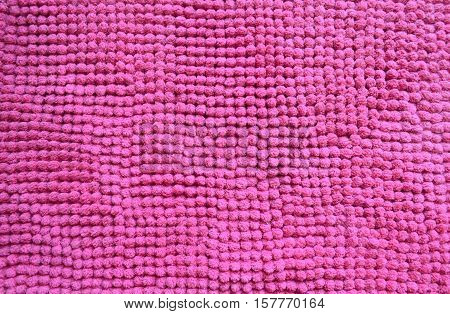 Pink and soft doormat fluffy texture and background