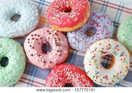 Delicious donuts on napkin, closeup