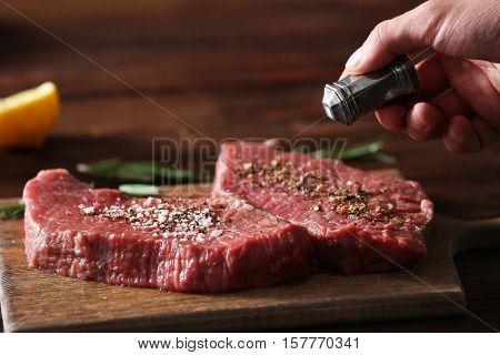 Butcher cooking pork meat on kitchen