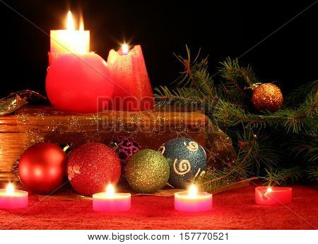 Different Christmas balls and candles close up