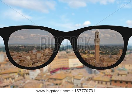 Clear image in woman sun glasses against sunny and blurry landscape