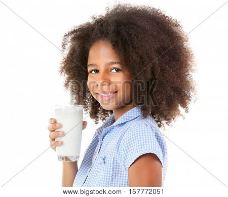 Cute curly African-American girl drinking milk on a white background