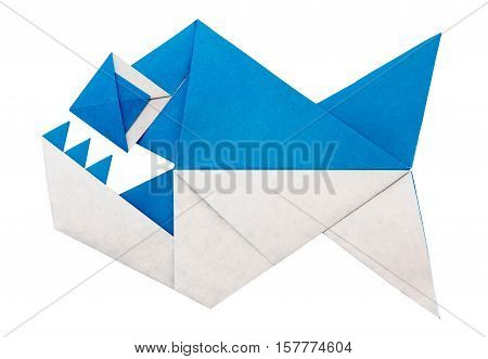 Origami paper piranha fish with teeth on a white background