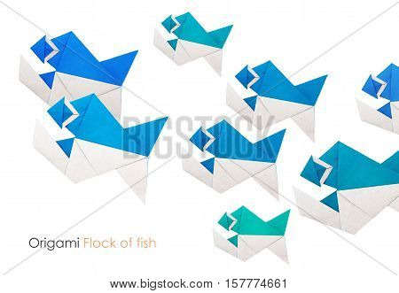 Origami paper piranha school of fish on a white background