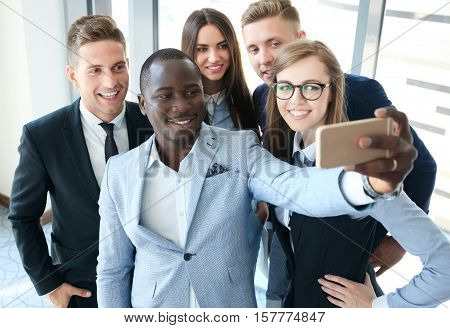 People taking selfie at business meeting in office