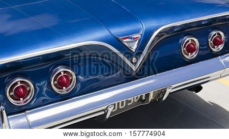 BRISBANE, AUSTRALIA - November 20, 2016: Detail of the rear section of a 1961 Chevy Bel Air car including the rear lights and Chevrolet badge in Brisbane Australia