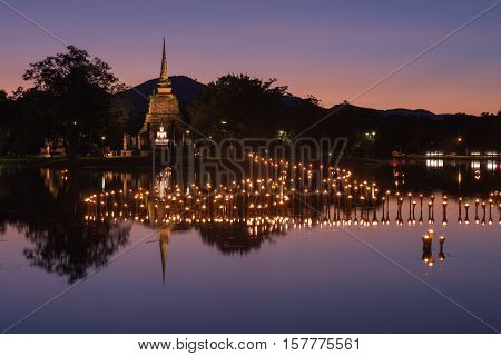 Light In Buddha Statue In Loy Kratong Festival, Sukhothai Historical Park , Thailand