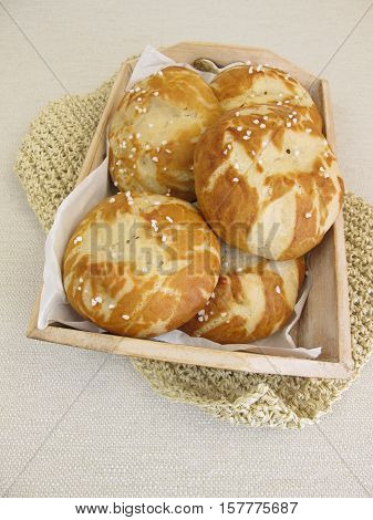 Homemade lye rolls on paper in small tray