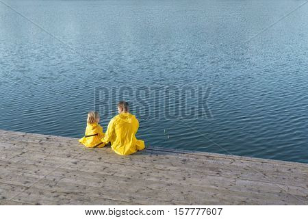 Family in yellow raincoats outdoors