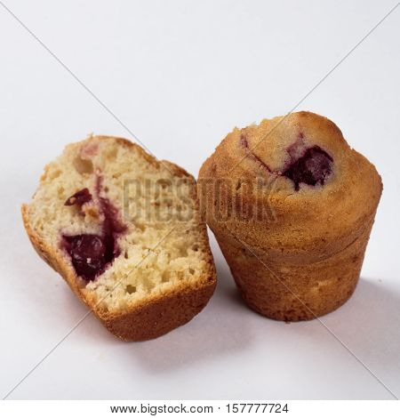 Cupcake with raisins homework on a white background in a cut.