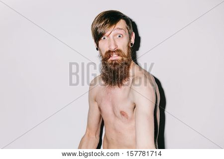 Portrait of a skinny bare chest man fooling for camera