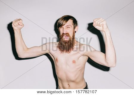 Portrait of a man on white studio background shouting