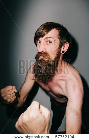 Portrait of a bearded man bringing his fists up