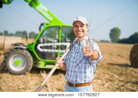 Happy farmer giving thumbs up