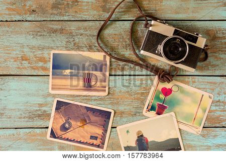 Photo album of remembrance love and nostalgia in summer journey trip on wood table. instant photo of camera - vintage and retro style