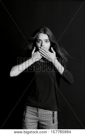 Speak no evil. The girl closes your mouth. Long hair
