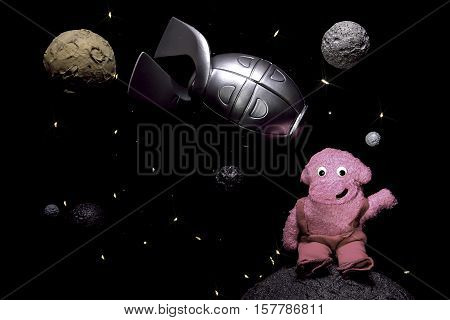 Friendly alien. Children's space scene with rocket and friendly alien amongst the stars and planets of outer space.
