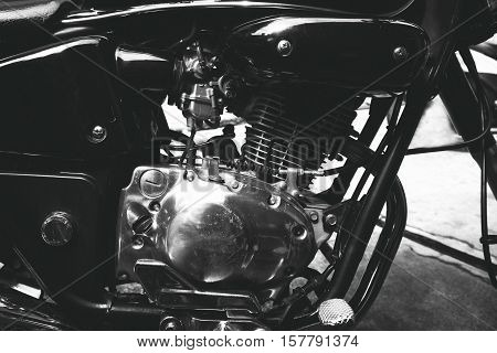 black and white photo - The engine of vintage classic motorcycles