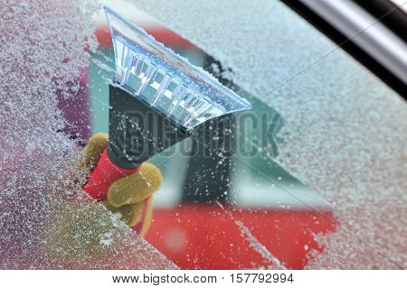 cleaning car windows from ice, close up