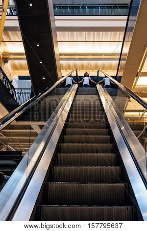 Amsterdam Netherlands - August 1 2016: Low angle view of escalators of the lobby of Magna Plaza Shopping Center in Amsterdam. Indoor view
