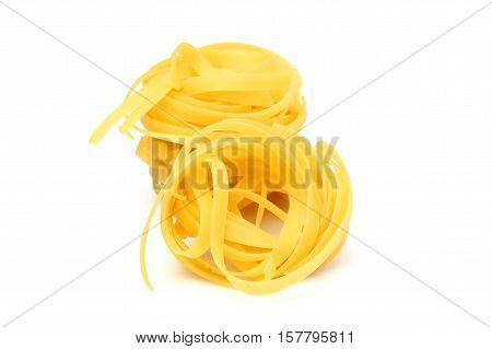 Fettuccini pasta isolated on a white background.