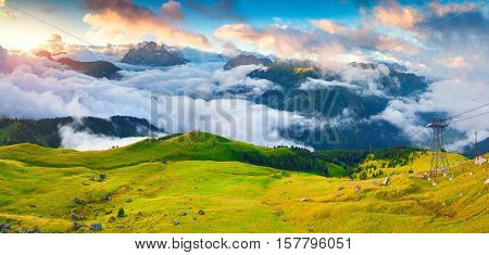 Panorama Of The Foggy Val Di Fassa Valley With Passo Sella