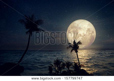 Artwork fantasy styles - Beautiful tropical beach with milky way star and full moon in night skies. Retro with vintage color tone (Elements of this moon image furnished by NASA)