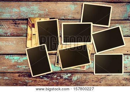 Empty old instant paper photo album on wood table - blank photo frame vintage and retro style