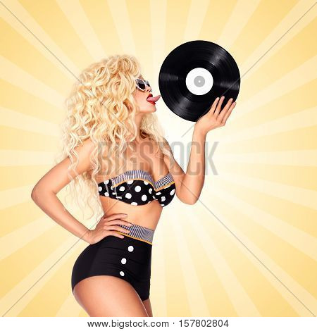 Beautiful pinup bikini model licking LP microgroove vinyl record on colorful abstract cartoon style background.