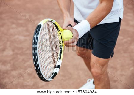 Cropped portrait of tennis player on court. tennis man