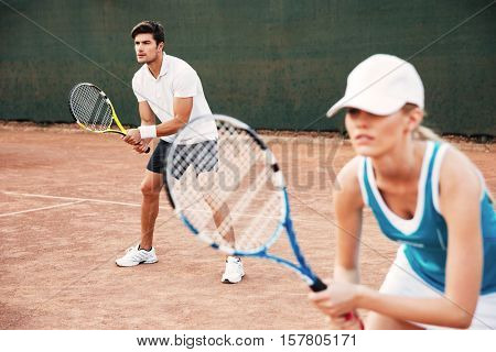 Young tennis players playing in tennis on court