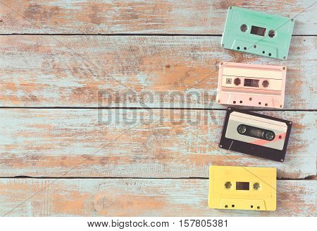Top view (above) shot of retro tape cassette on wood table - vintage pastel color effect styles