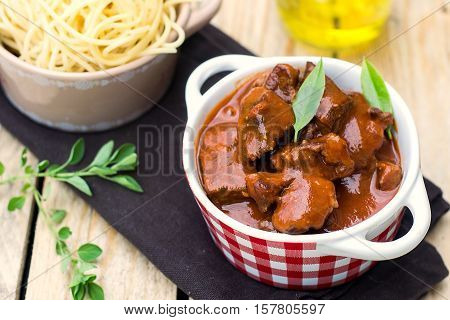 Beef stew goulash with gravy served with pasta