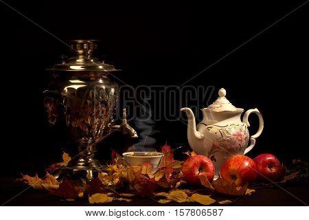 Tea still life / Tea still life with a samovar and apples