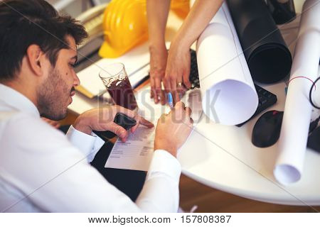 Architect working with construction tools in office
