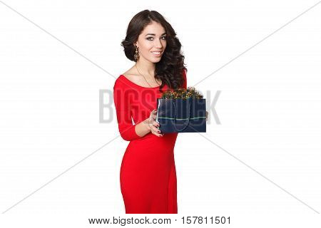 people luxury holidays and sale concept - picture of lovely woman in red dress with shopping bag. over white background portrait