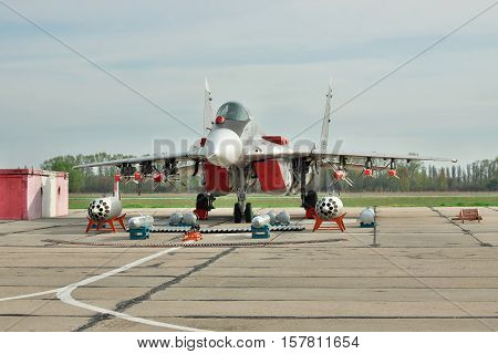 Vasilkov Ukraine - April 24 2012: Ukraine Air Force MiG-29 on the airfield with its weapons near on the ground